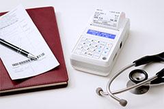 Kasa fiskalna Posnet Mobile HS EJ - Posnet Mobile HS EJ w gabinecie lekarskim